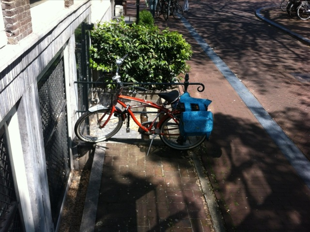 My orange bike parked in the shade by Jeff's office on the Keizersgracht